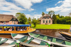 Tourists enjoying a canal cruise with a wooden boat in the famou Stock Photo