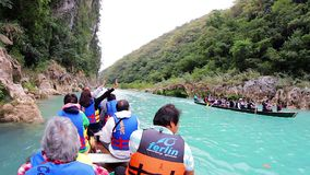 Tourists enjoying a canoe ride on the Santa Maria River to see the Tamul waterfall. SAN LUIS POTOSI, MEX 2016 (ILLUSTRATIVE IMAGE). Tourists enjoying a canoe stock video footage
