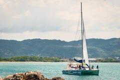 Tourists enjoying catamaran cruise on sunny day on the ocean in Montego Bay Jamaica stock image
