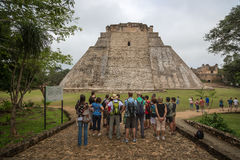 Tourists enjoying a cloudy day at the Chichen Itza Ruins in Mexico Royalty Free Stock Images