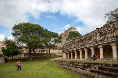Tourists enjoying a cloudy day at the Uxmal Ruins in Mexico. Royalty Free Stock Photos
