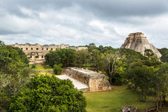 Tourists enjoying a cloudy day at the Uxmal Ruins in Mexico. Stock Image