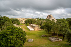 Tourists enjoying a cloudy day at the Uxmal Ruins in Mexico. Royalty Free Stock Image