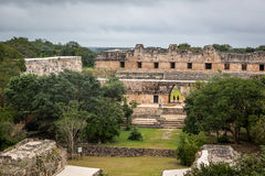 Tourists enjoying a cloudy day at the Uxmal Ruins in Mexico. Stock Photo