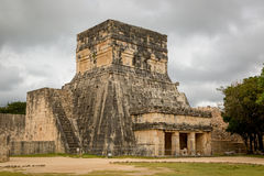 Tourists enjoying a cloudy day at the Uxmal Ruins in Mexico. Uxmal, Mexico - January 12th 2014 Tourists enjoying a cloudy day at the Uxmal Ruins in Mexico stock photography