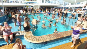 Tourists enjoying on the cruise ship-swimming,sun bathing and chatting;cruising near Bermuda islands,North Atlantic ocean. 23th of November,2016 stock footage