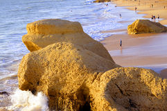 Tourists enjoying the evening sun on Praia Da Gale Beach Stock Photography