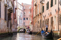 Tourists enjoying the gondolas in Venice, Italy Royalty Free Stock Image