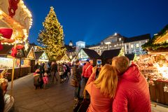 Tourists enjoying Graz Christmas market and taking pictures at t. He Christmas tree stock images