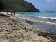 Tourists enjoying an idyllic beach in the caribbean stock video