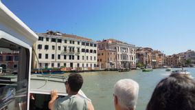 Tourists enjoying leisure trip around Venice on board of vaporetto water taxi. Stock footage stock video