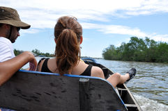 Tourists enjoying Mekong delta cruise with daily trip in a boat Royalty Free Stock Photo