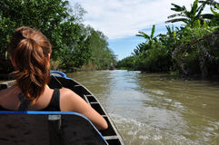 Tourists enjoying Mekong delta cruise with daily trip in a boat Royalty Free Stock Photography