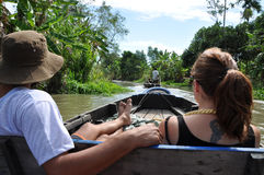 Tourists enjoying Mekong delta cruise with daily trip in a boat Stock Image