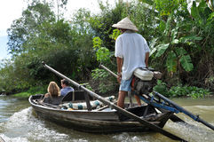 Tourists enjoying Mekong delta cruise with daily trip in a boat Royalty Free Stock Images