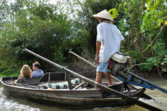 Tourists enjoying Mekong delta cruise with daily trip in a boat Stock Photos