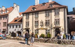 Tourists enjoying outdoor bars, shops and gift sellers in the historic center of Riga, Latvia Royalty Free Stock Photos
