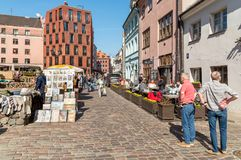 Tourists enjoying outdoor bars, shops and gift sellers in the historic center of Riga, Latvia Stock Images
