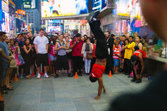 Tourists enjoying a performance in Time Square, New York Royalty Free Stock Photo