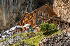 Tourists enjoying relaxing time at Aesher mountain hut in Swiss stock images