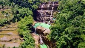 Tourists enjoying scenery of exotic Cigangsa waterfall. Aerial view of tourists enjoying scenery of exotic Cigangsa waterfall in Sukabumi, West Java, Indonesia stock images