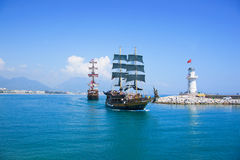 Tourists enjoying sea journey on vintage sailships in Alanya, Tu. ALANYA, TURKEY - MAY, 5: Tourists enjoying sea journey on vintage sailships on May 5, 2012 in Royalty Free Stock Images