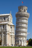 Tourists Enjoying Sunny Day In Front Of the Leaning Tower of Pisa in Tuscany Italy Stock Photography