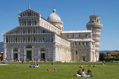 Tourists Enjoying Sunny Day in Front Of the Leaning Tower of Pisa in Tuscany Italy Royalty Free Stock Images
