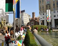 Tourists enjoying the sunny day at San Babila square during Carnival. Royalty Free Stock Photography