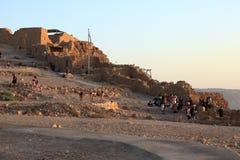 Tourists enjoying the Sunrise in Masada Stock Photos
