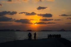 Tourists enjoying the sunset and the Atlantis Hotel Stock Images