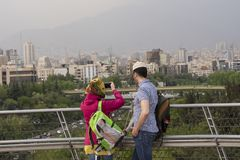 Tourists enjoying and taking panoramas from Tehran skyline royalty free stock photography