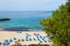 The tourists enjoying their vacation on the beach Stock Photos