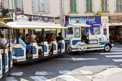 Tourists enjoying a tour on the Little Train in Cannes Royalty Free Stock Photos