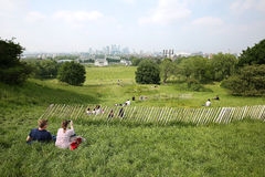Tourists enjoying the view of London from on top of Greenwich Park Royalty Free Stock Photos