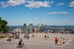 Tourists enjoying view of Montreal skyline. Montreal, CA - 7 July 2018: Tourists enjoying view of Montreal skyline from Kondiaronk Belvedere located at the top stock photography