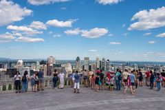 Tourists enjoying view of Montreal skyline royalty free stock image