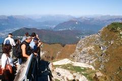 Tourists enjoying the view from mount Generoso at lake Lugano Royalty Free Stock Image