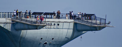 SAN DIEGO, CA - USS Midway tail view. Tourists enjoying the view off of USS Midway Museum in San Deigo royalty free stock image
