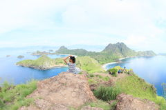 Tourists enjoying view on Padar Island royalty free stock images