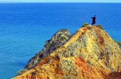 Tourists enjoying the view from the top of path to the spectacular rock f Royalty Free Stock Images