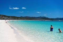 WHITSUNDAYS, AUSTRALIA - AUGUST 24TH: Tourists enjoying the clear blue water and white silicon sand of Whitehaven Beach in the stock photo