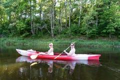 Tourists enjoying water sports, kayaking Royalty Free Stock Photos