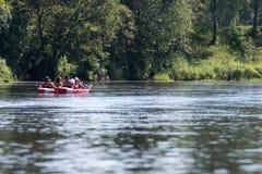 Tourists enjoying water sports, kayaking Royalty Free Stock Images