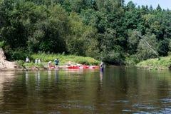 Tourists enjoying water sports, kayaking Royalty Free Stock Photo