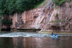 Tourists enjoying water sports, kayaking Royalty Free Stock Image
