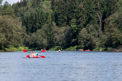 Tourists enjoying water sports, kayaking Stock Photos