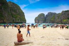 Tourists  enjoying on the white sand the beach of Maya Bay Stock Image