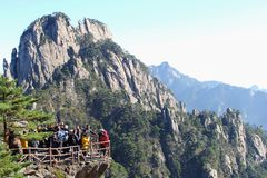 Tourists enjoy the panorama in the Yellow Mountains, China Royalty Free Stock Image
