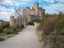 Tourists entering medieval castle of Loarre in Aragon, Spain Stock Images